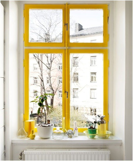 Paint your window trim yellow. Image via  Apartment Therapy