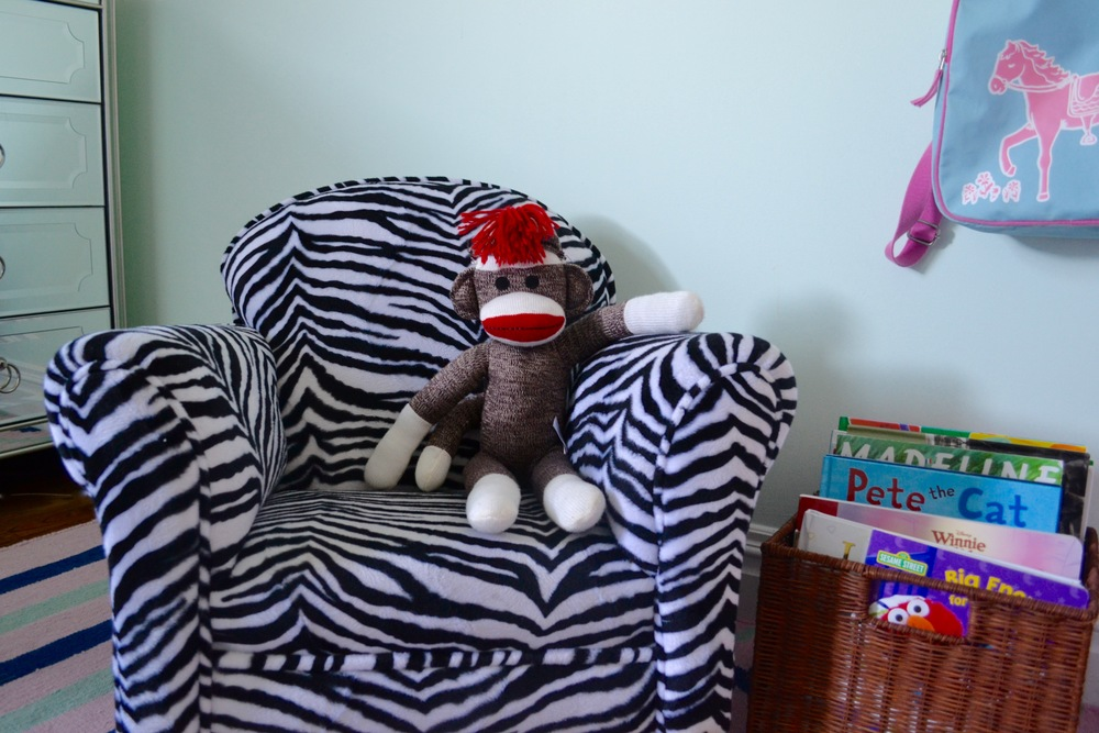 Sock Money chillin' in his zebra rocking chair, waiting for story time.