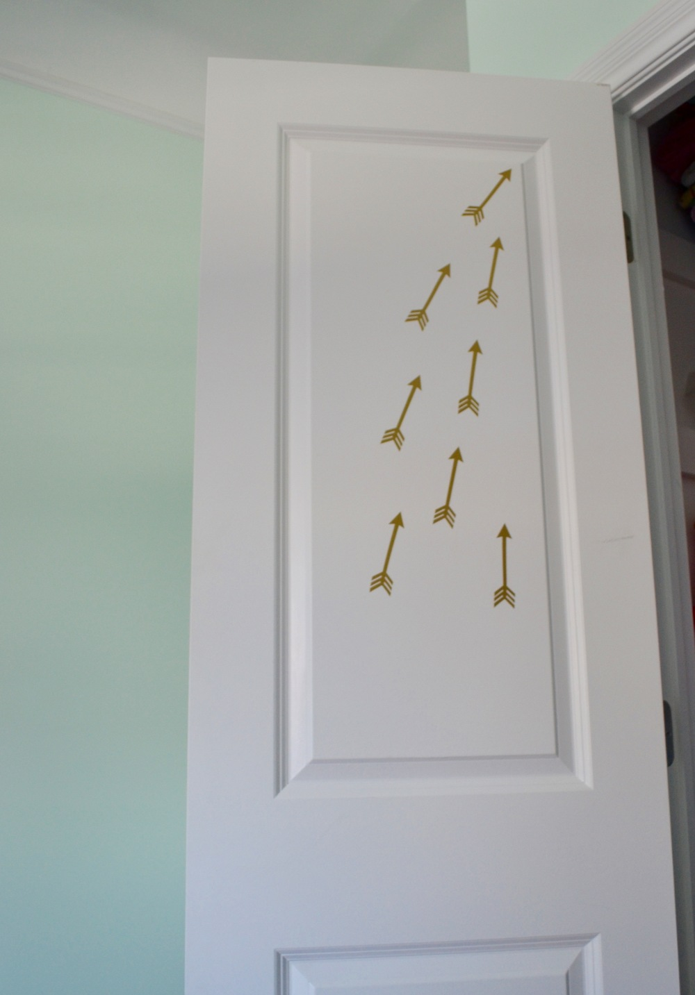 Flying Arrow Decals adorn the inside of the closet door - because, why not?