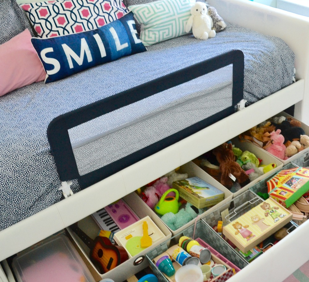 The daybed has a trundle drawer that allows for a mattress, but we opted to use it as  toy storage  instead by adding bins to compartmentalize.