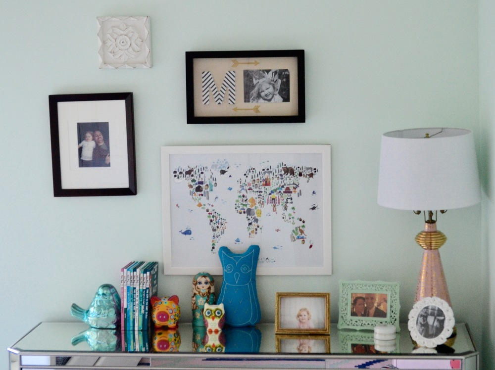 The gallery wall is a collection of Awesome Family's previously owned frames, a ceramic wall plaque from Client M's grandma. Awesome Family loves to travel around the world, so I snagged this whimsical map print at Homegoods.
