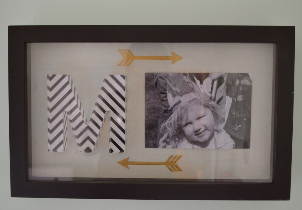 I had fun with this DIY while installing: Awesome Family's previous owned shadowbox + acrylic letter M from Marshall's + black and white photo + leftover wall decals = Custom Personalized Wall Art.
