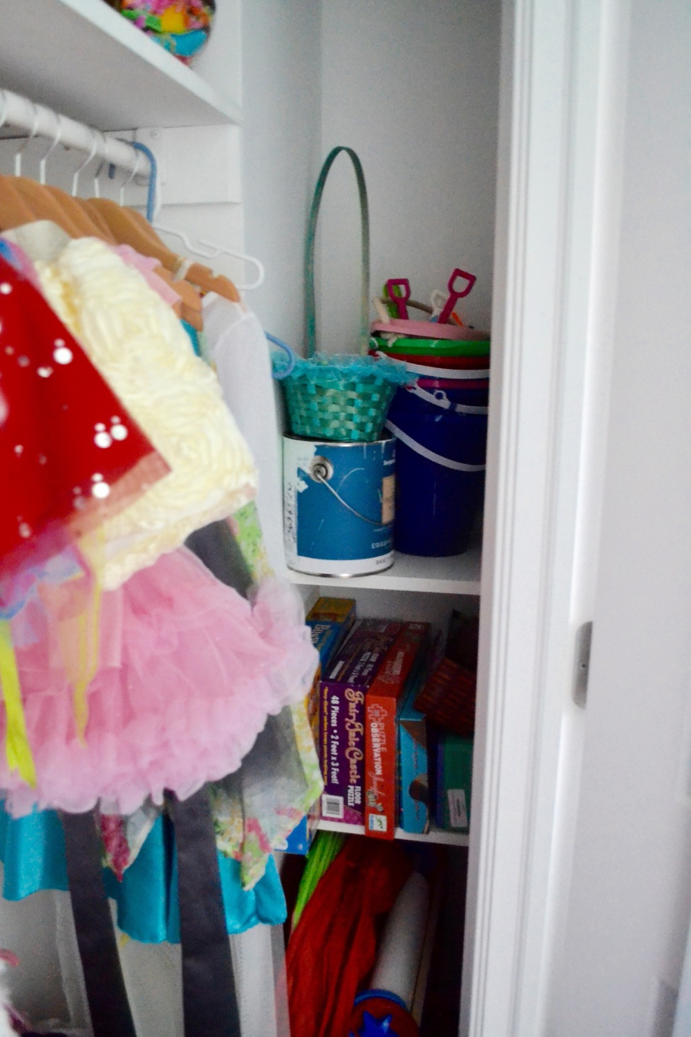 The closet is pretty deep and has a tucked away side shelf that allows for plenty of toy and game storage.