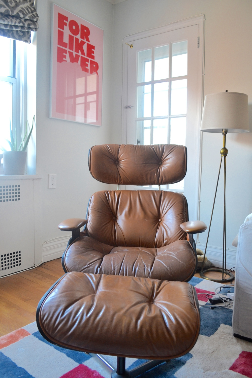 The leather Eames style Chair and Ottoman were a vintage find from Craigslist.