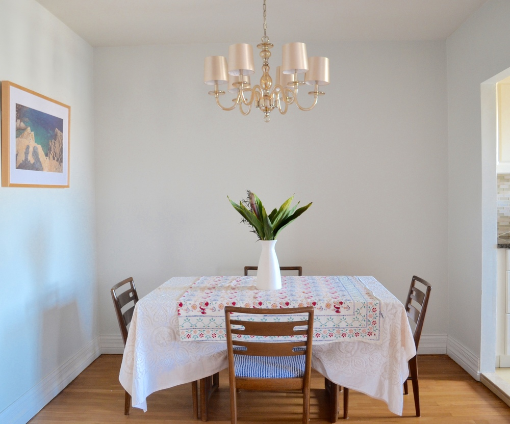 Sweet and Simple - the formal dining area is open to the living room. The table and chairs were vintage Craigslist finds, upholstered by Client Crafty.
