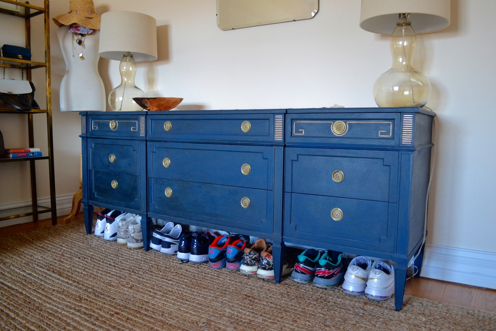 Across the room lives quite possibly the best Craigslist hack ever. Such a beautiful secondhand find. Client Crafty spent weeks refinishing this amazing storage workhouse and painted it a deep moody blue, making the brass accents really pop.