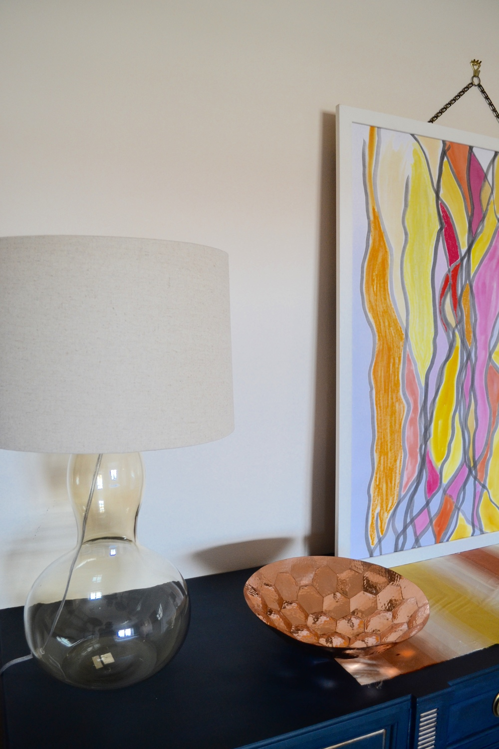 The lamps are from West Elm. Table runner and art by Client Crafty.