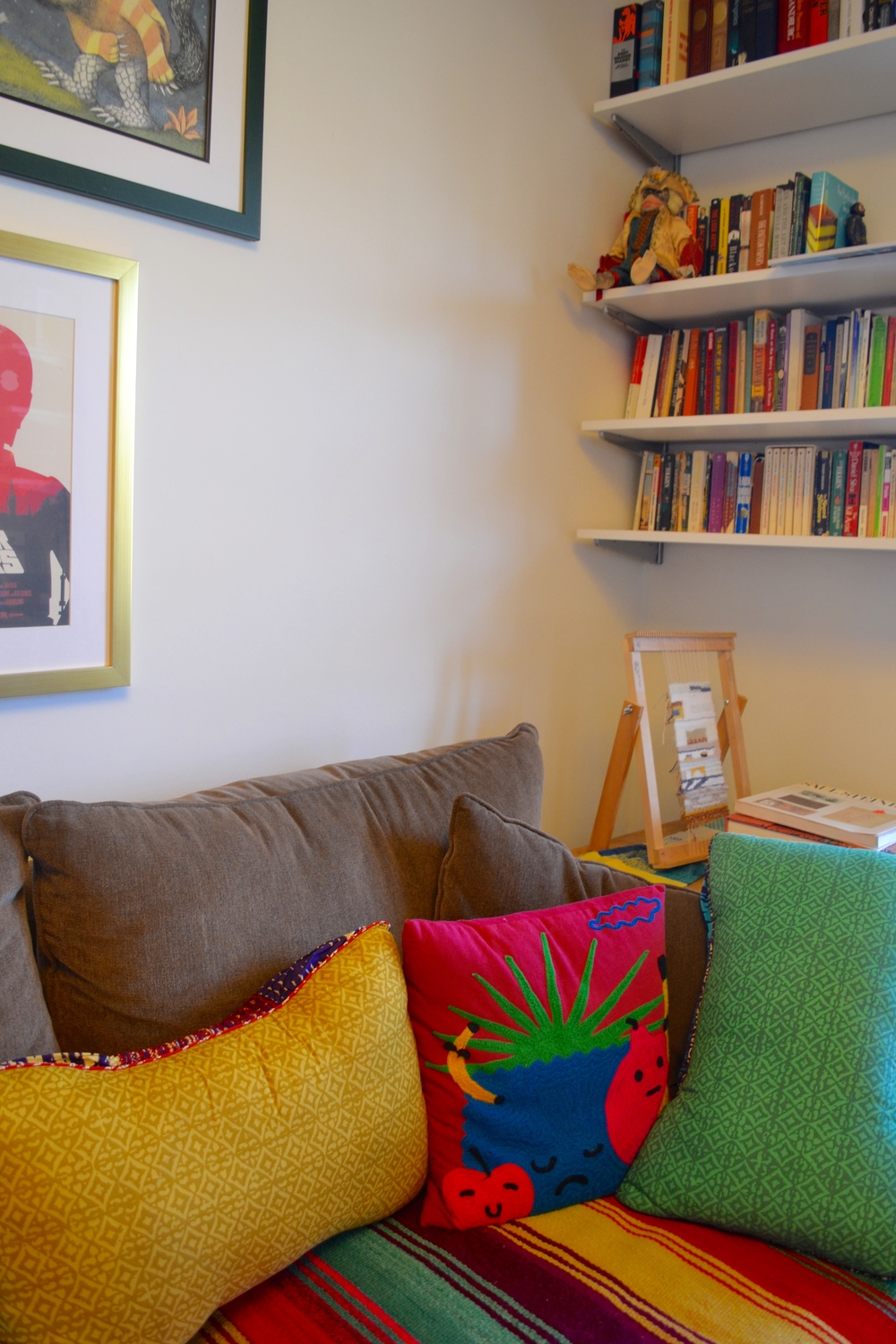 """Love the pineapple pillow and the fun punchy colors. And yes, that's a little sliver of some """"Where the Wild Things Are"""" art up in the corner."""