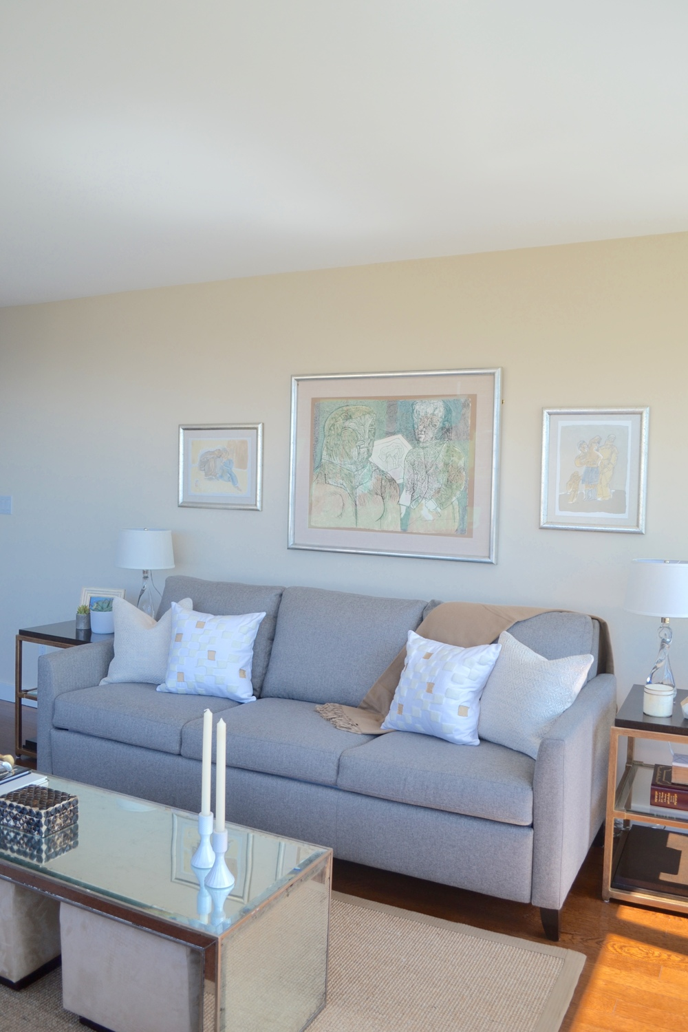 I'm in love with the client's original art (by a famous Mexican artist whose name escapes me at the moment!). It happened to blend perfectly with our scheme of warm beiges and grays and fit perfectly as a gallery installation over the sofa.