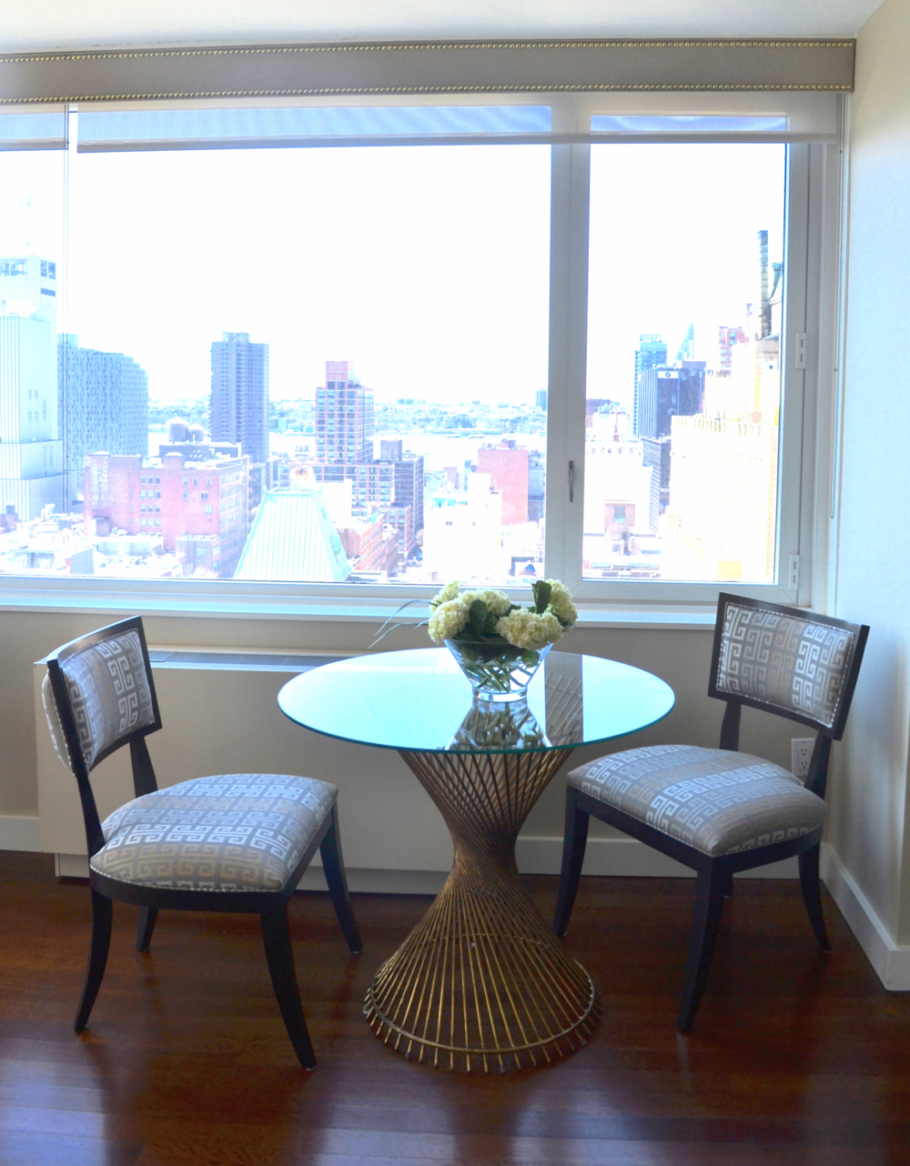 I fell in love with this modern greek key fabric and klismo style chairs, so I'm glad my clients did as well!