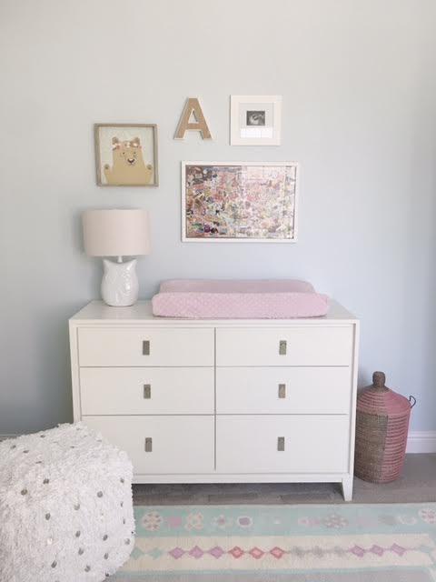 Decided to switch it up and do a gallery wall over the changing table instead of the mirror this go round. Couldn't resist the  bear print  from Pillowfort by Target. Also featured in this lovely gallery wall is a wooden A from Marshalls, a  framed sonogram pic , and a collage handmade for Avery's by her grandmother Mimi. The hamper basket is by West Elm.