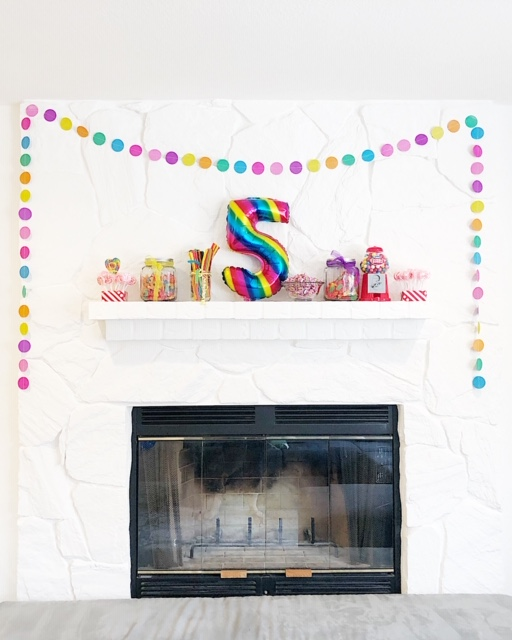 our white painted mantel with non committal art is the perfect back drop for more candy and party decor!