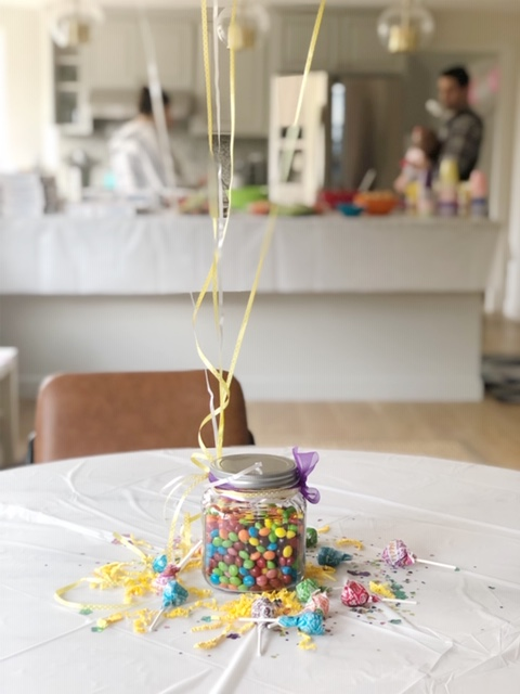We took a jar of candy, tied a ribbon and some balloons around it and boom! you've got an adorable festive centerpiece.