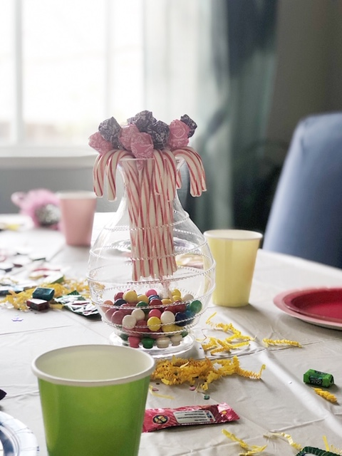 No table is complete without centerpieces. So grabbed vases that we already had and made these candy displays.