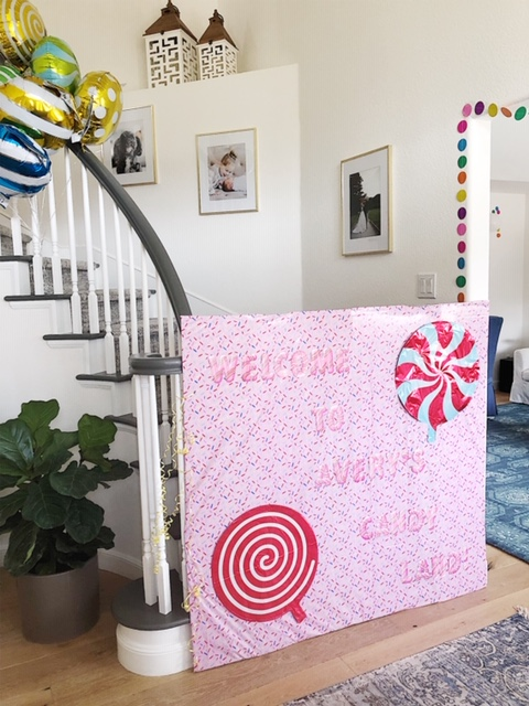 First things first, we had to block off these stairs, so the party animals didn't monkey around upstairs! I crafted this out of a giant box , tablecloth,  foil balloons, and stick on letters.