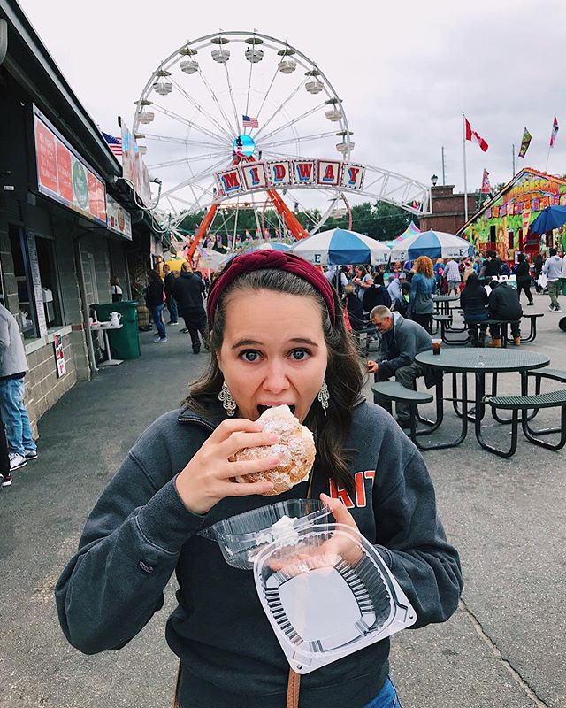 """🎪 Ate my way (and weight) through the Big E! The most epic cheat day of all time. . Pictured: cream puff, Maine Baked Potato, fried cheese curds, New Hampshire corn, fried veggie basket, dole whip, Mac Melt. . Like my headband? Check out @piecestopeaces! The headbands are handmade by local women in Washington state. Use code """"EMILYREP"""" for a discount on your purchase. . . . #bige #thebige #bigefood #bigefair #bigefairfoodie #fairfood #cheatday #visitnewengland #thebigefair #springfield #springfieldma #ma #visitma #monday #foodie #foodiegram #creampuff #mainebakedpotato #cheesecurds #macmelt #dietstartstomorrow"""