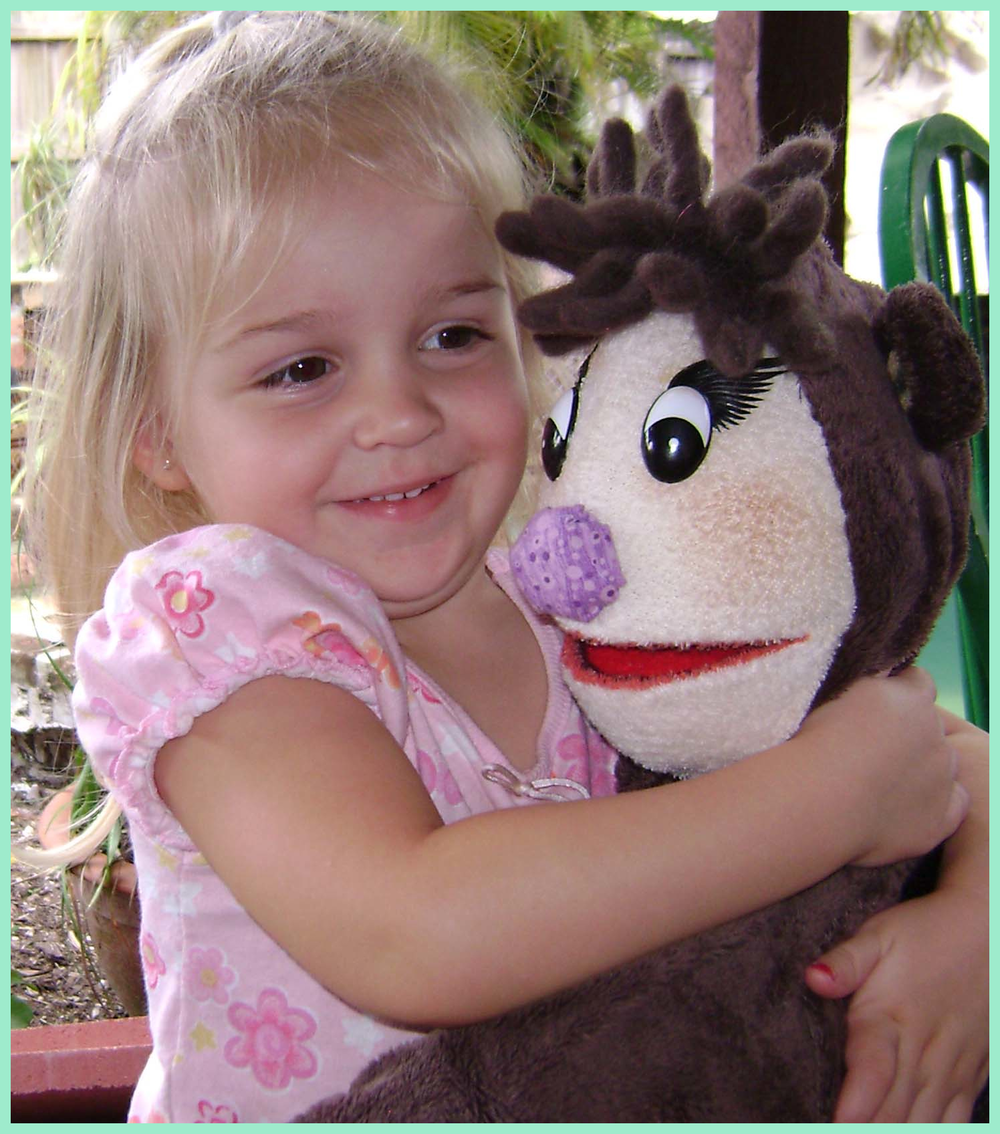 JSS- little girl with puppet.png