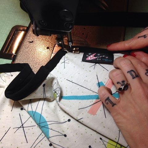 The beautiful fingers of our master seamstress Geneviève at work. Did you know that all of our couture items are handcrafted in Montreal, Canada? #thecraveyard #midcentury #midmod #pinup #vintage #brooch #brooches #1950s #1960s #retro #vlv #pinupgirlclothing #franciscanstarburst #vintagesewing #tattooedknuckles #seamstress #montrealdesigner #madeincanada