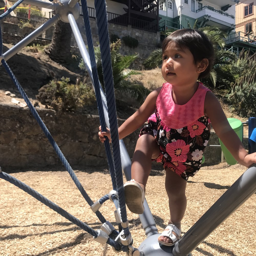 Camilla enjoying what she does best, playing in a new and cool playground we ran into.  This playground is located in the center of the city.