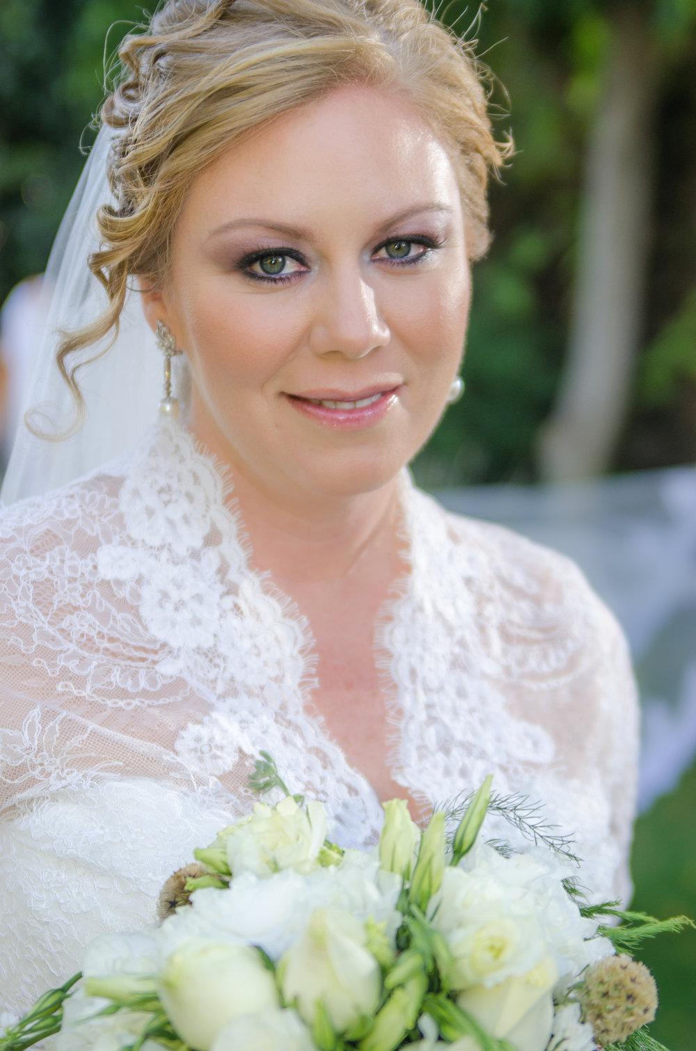 white dress, white bouquet, green eyes