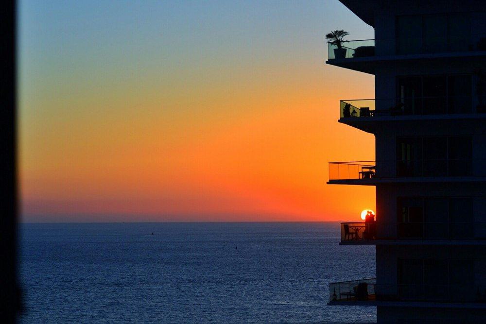Epic beach sunset Kiss on the balcony
