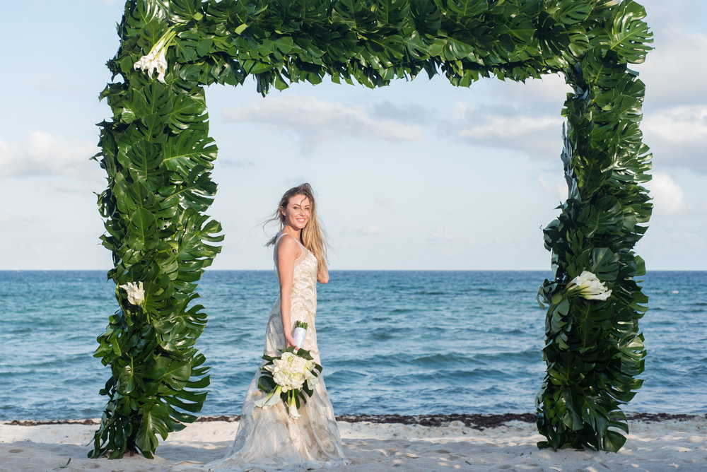 Super happy bride shot in front the ocean on the gazebo