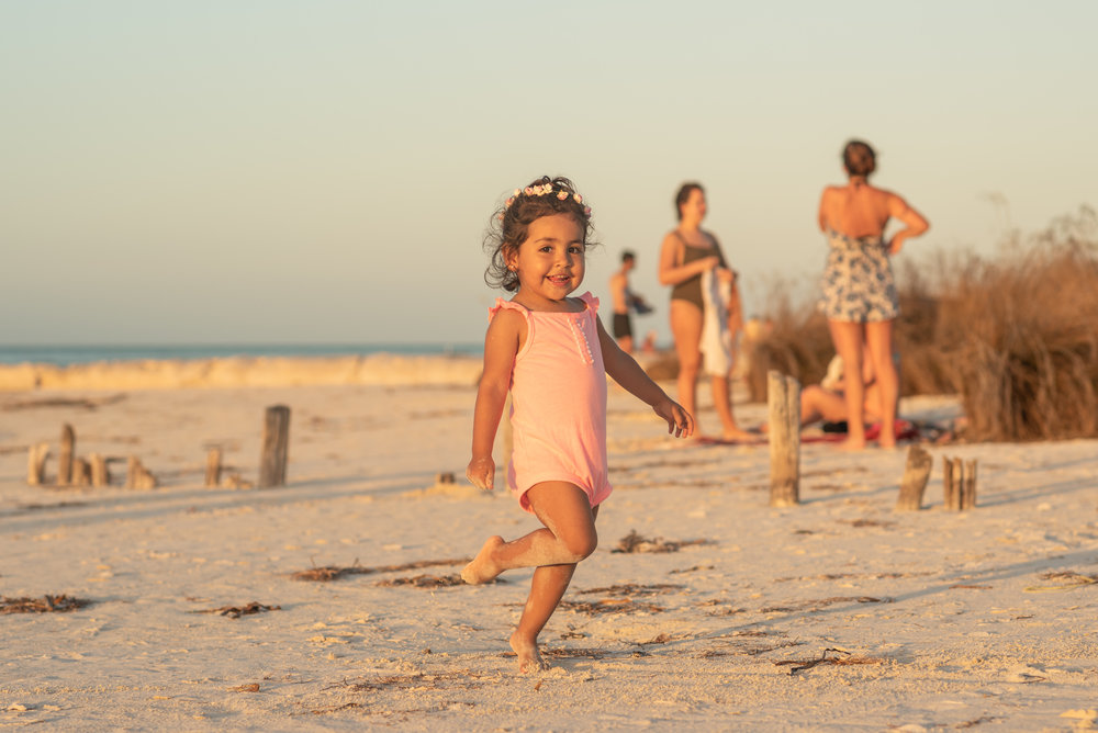 baby dancing on the holbox island sand