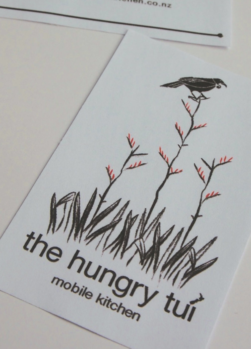 [The Hungry Tui]  Creation of a brand identity for a new business . September 2013. [Above front of the business card and crop of back]