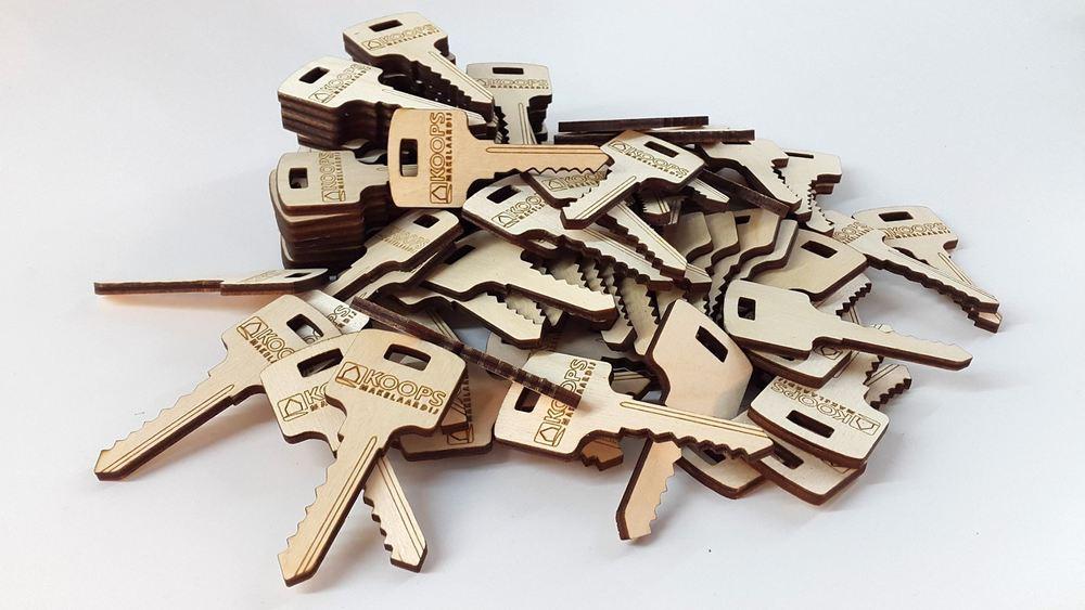 In samen werking met het Printhuis mochten we deze gave sleutels snijden voor Koops Makelaardij.