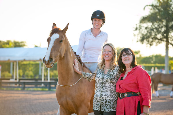 Elisa Wallace, Ellie Phipps Price, and Suzanne Roy with Rune the mustang in Wellington, FL