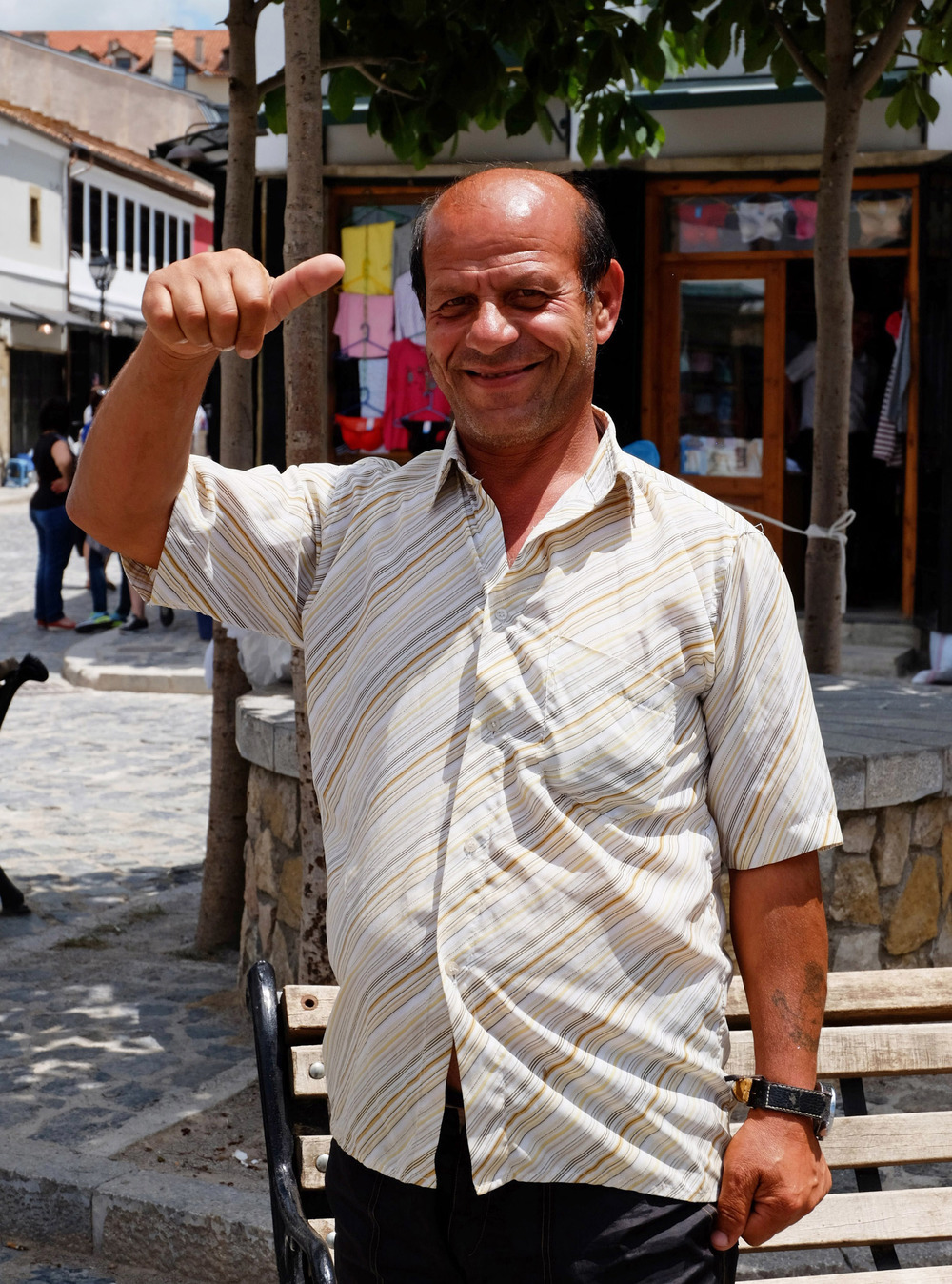 After posing for this picture, this gentleman was eager to sell us some watches at his little shop.