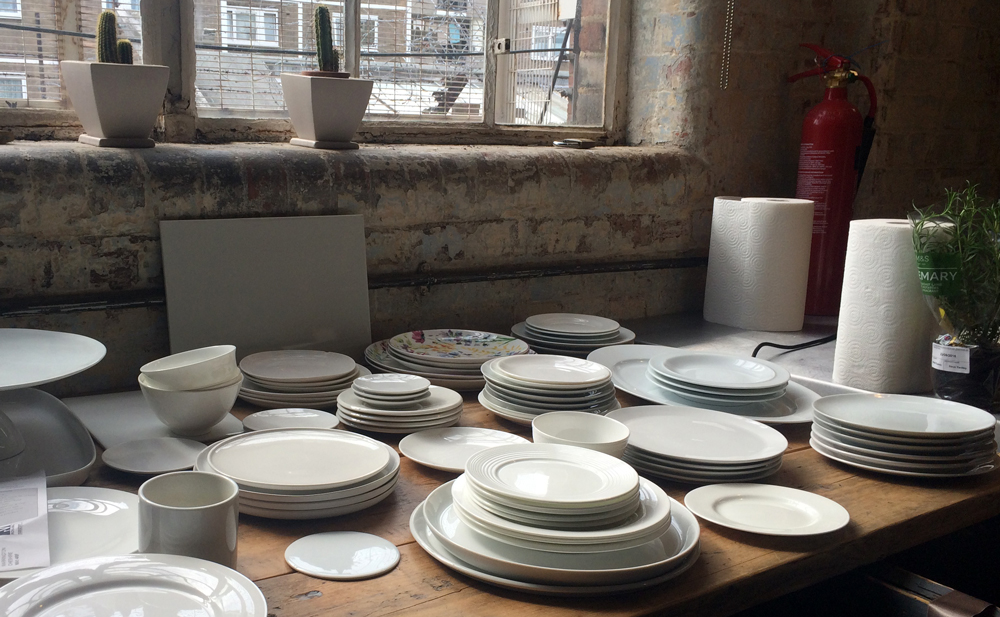 Lots of white plates and props styled by Lydia Brun