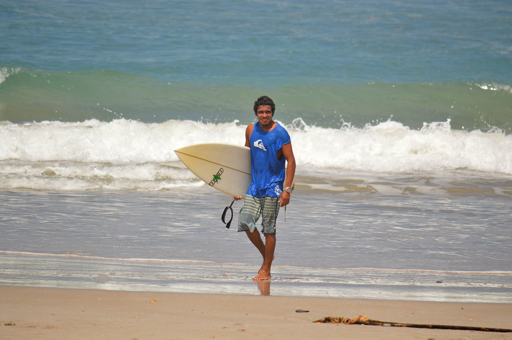 Miguel exiting the water after another fun day surfing.