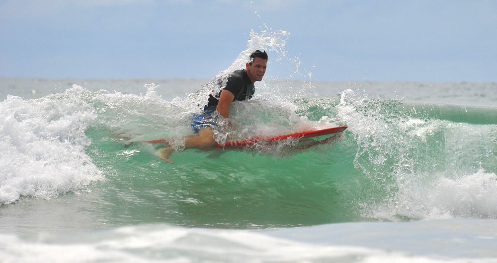 fun-action-shot-surf-lessons-costaricantropicaltours.jpg