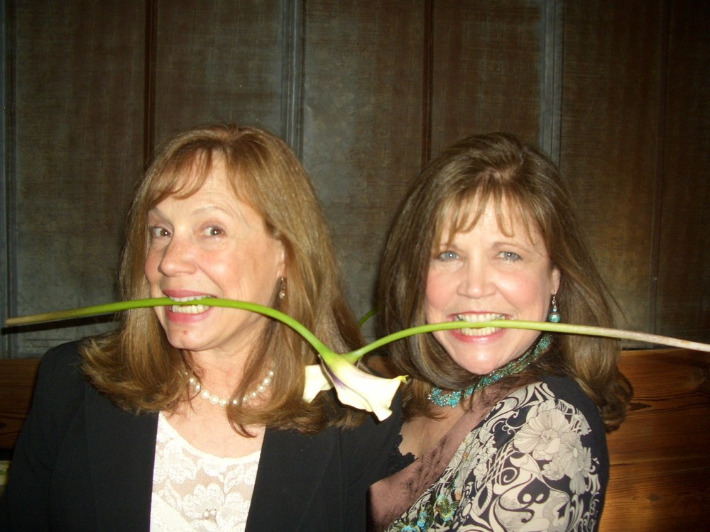 janet and me with flowers in teeth.jpg