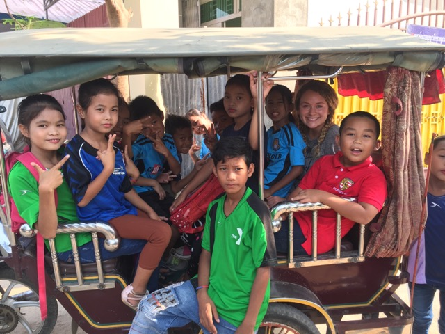 Jessica and some of the children on a tuk-tuk enrollee to a stake Khmer New Year celebration.
