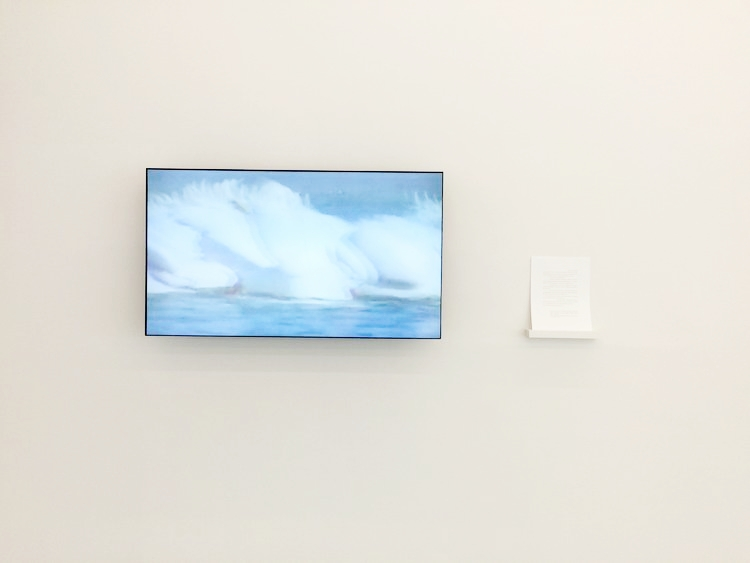 Installation view of Lockport Wave, 2017, video and text by Kristina Banera.