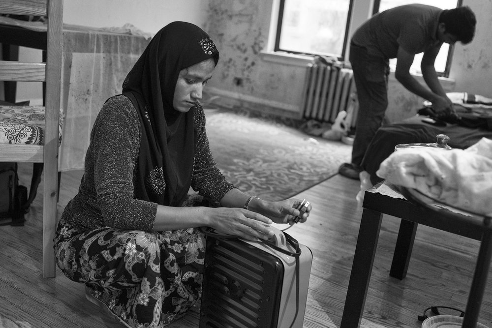 "Laila sets up a space heater in her new living room.  She has never experienced a winter before. ""There was no one listening in Burma,"" said Laila in an interview before the Rohingya crises escalated into, what the many have called, a genocide."