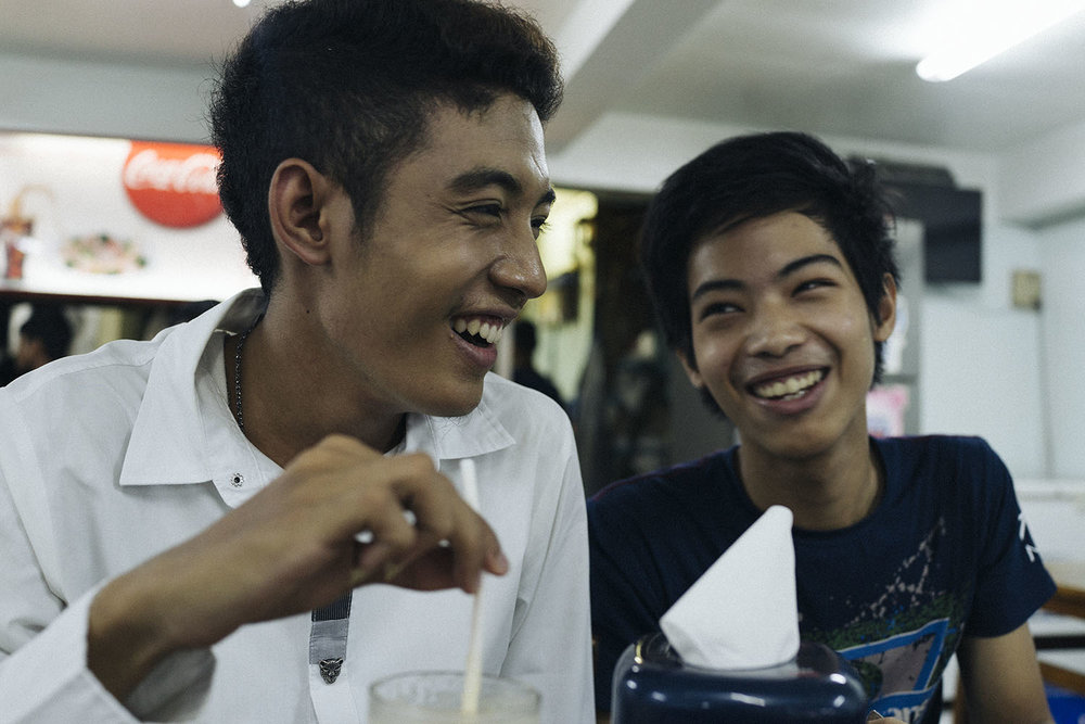 Damian and his childhood friend, Myat Kyaw (Mitchell), 17, grab a bite to eat at a tea house.