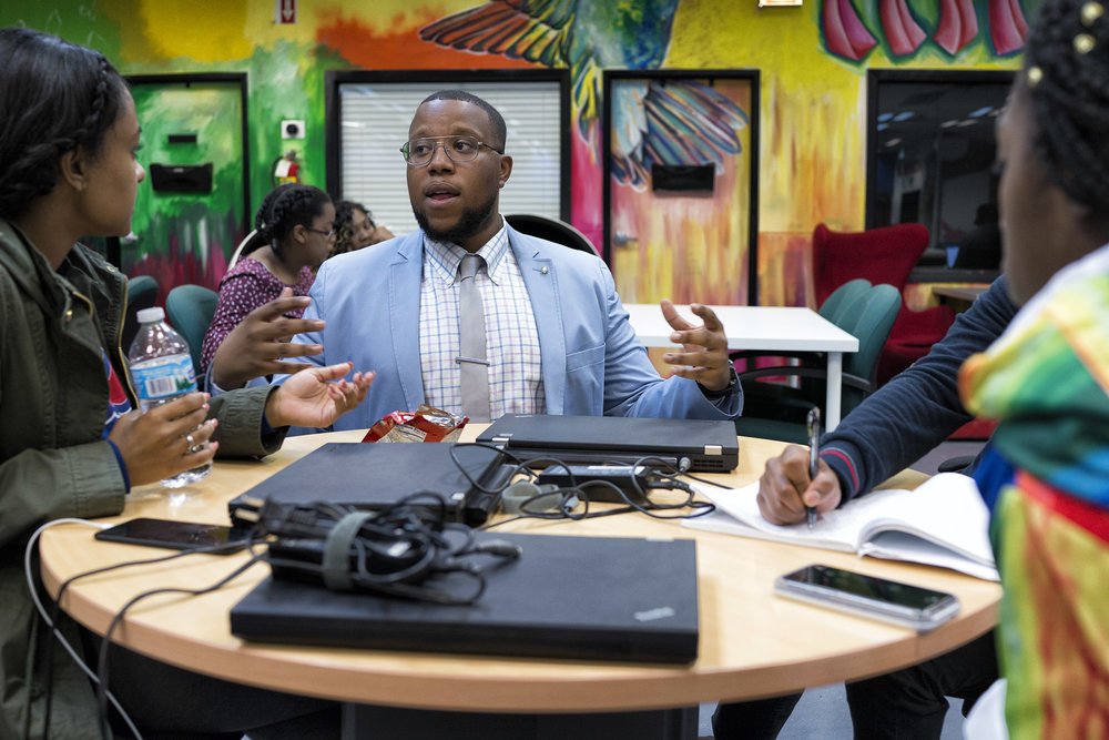 Channing Harris, creator of the app Excuse Me Officer, talks to teenagers at Gray Matter Experience, an entrepreneurial experience program at Blue1647. (Chicago Tribune - October 20, 2016)