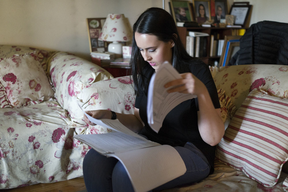 Kayla Gubov flips through her MAP grant information on June 9, 2016, in Skokie. Gubov said she plans to leave Illinois for a school that can provide more financial stability. (Chicago Tribune - June 17, 2016)