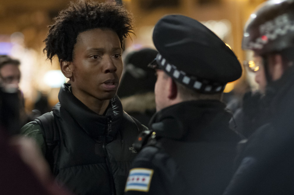 A protestor and a police officer face off after the video is released of local teenager, Laquan McDonald, being shot by a Chicago police officer on November 24, 2015 in Chicago, IL.
