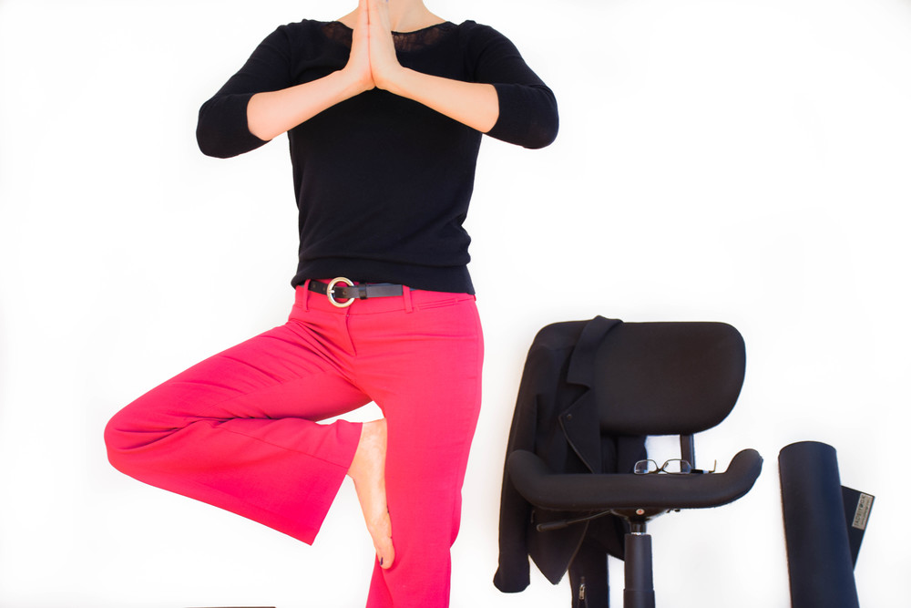 Yoga at work can mean simply breathing deeply at your desk