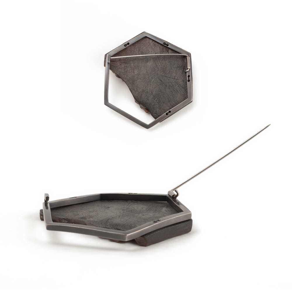 "Rubber Sole Brooch  (pin back details), 2015. Shoe sole, sterling silver, steel, silk thread, graphite, 23k gold-custed crud. 2.25"" x 2"" x 0.25"""