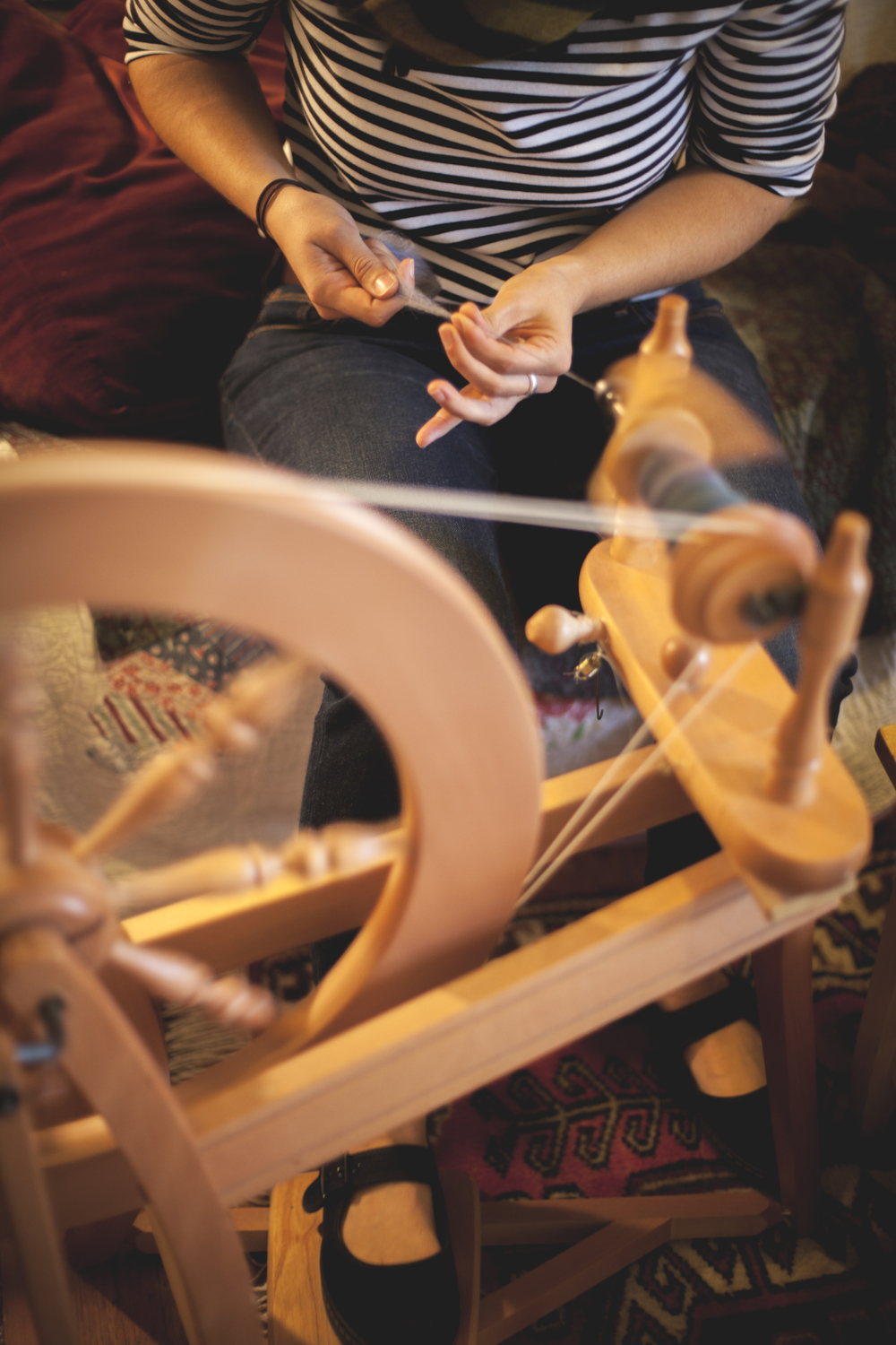 Zoe spinning yarn she hand dyed.