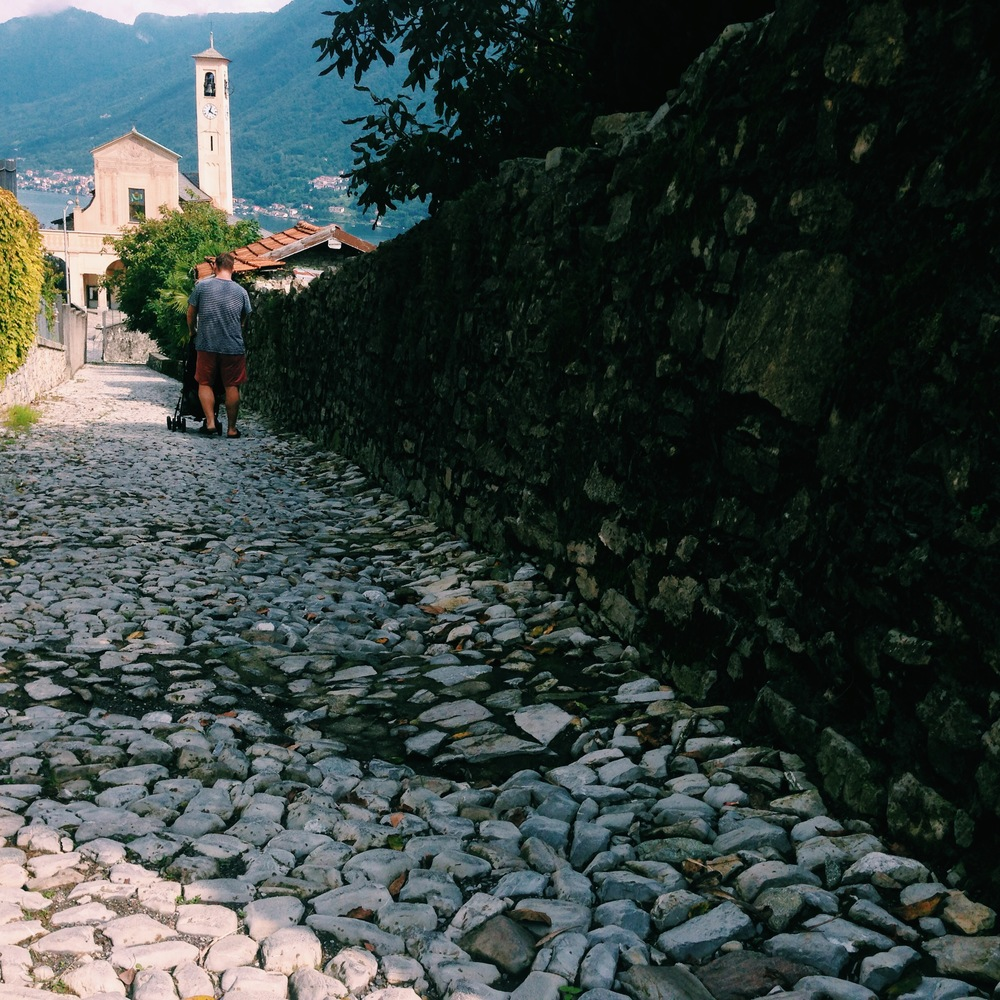 cobblestones may be charming, but they are sure do a number on an umbrella stroller.
