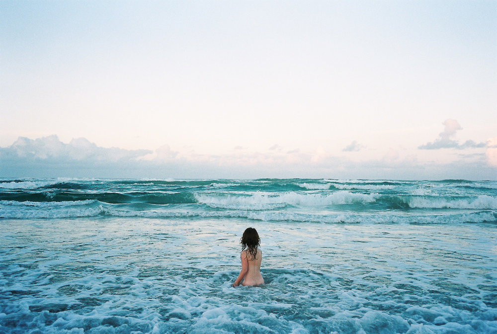 A girl wades into the ocean near Byron Bay, Australia by Kuala Lumpur photographer Erica Knecht