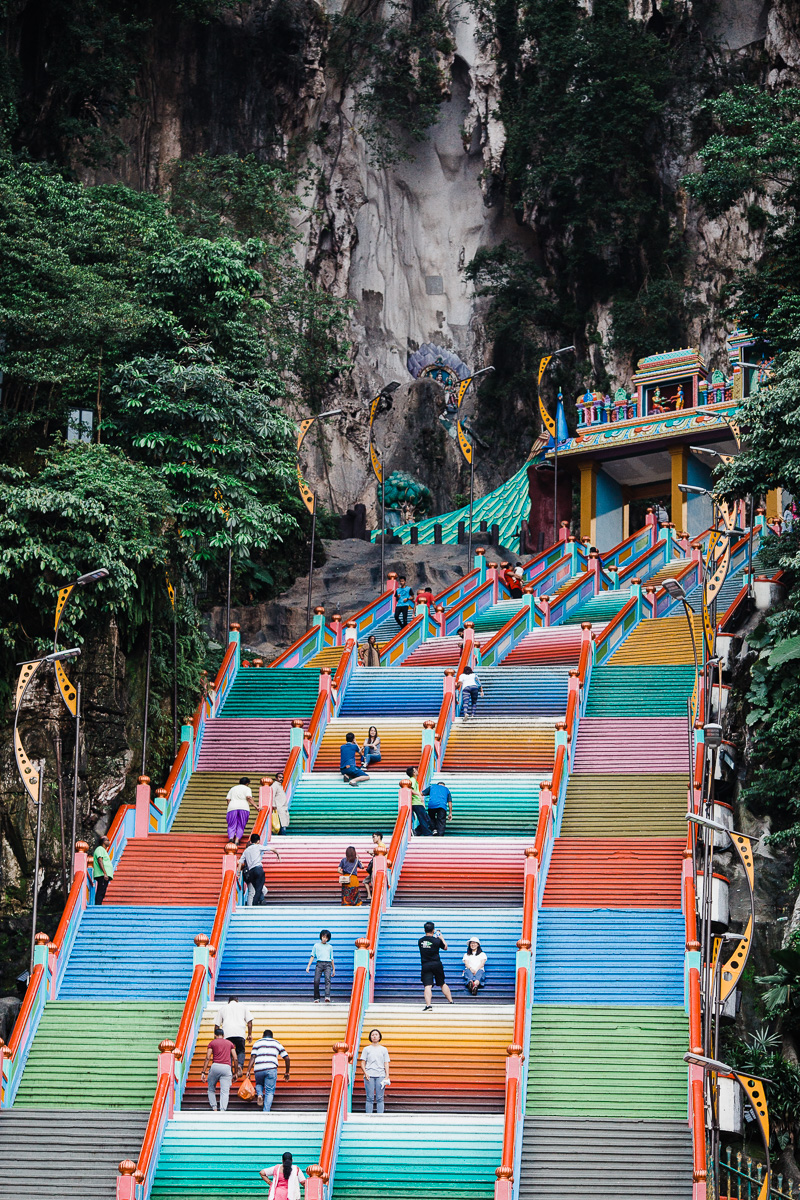The colorful stairs at Batu Caves, leading up towards the temple by Kuala Lumpur photographer Erica Knecht.