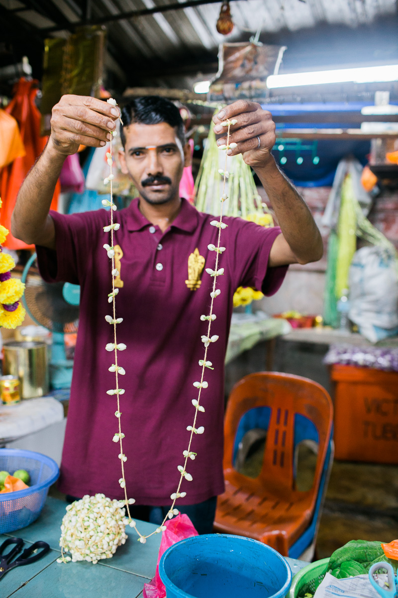 A man shows off a string of Jasmine in Kuala Lumpur.