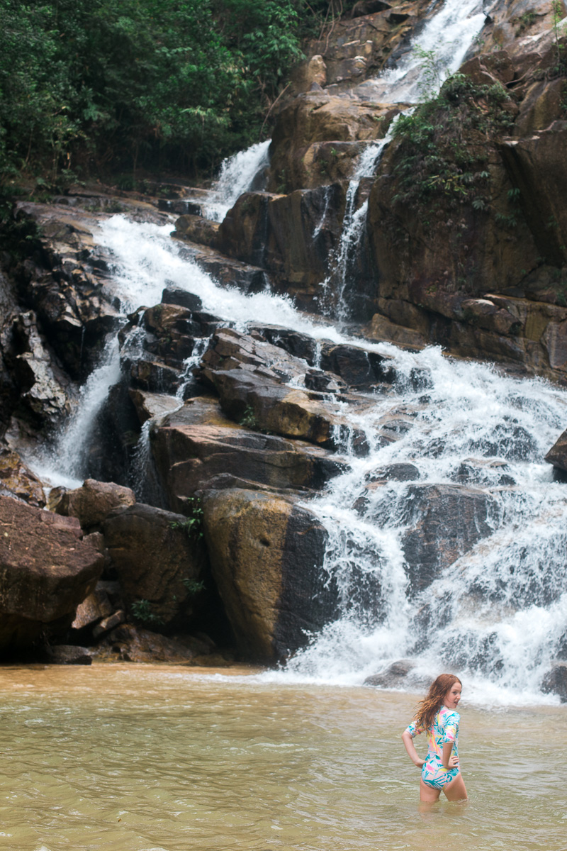 a girl stand in sungai pandan waterfall near kuantan by kuala lumpur photographer erica knecht